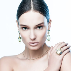Dolly Boucoyannis Whirling Wires Earrings and Three semi-precious stones ring on model