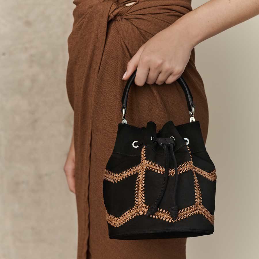 Marina Raphael ESTELLA Black Crochet Suede Bag on model