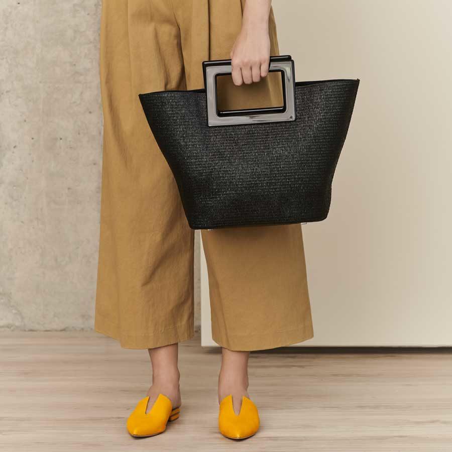 Marina Raphael Riviera black straw bag on model