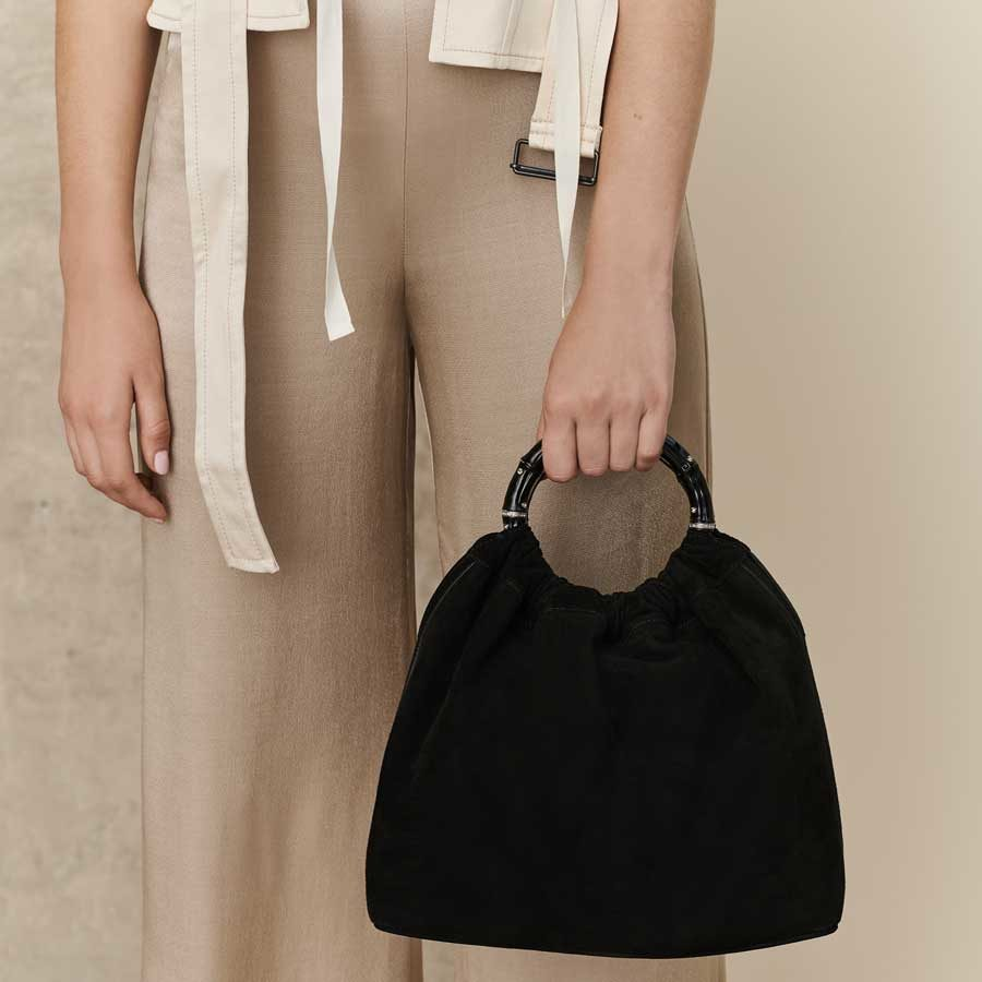 Marina Raphael SIENNA Black Suede Bag on model