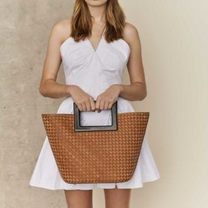 Marina Raphael RIVIERA Terracotta Woven Leather Bag on model
